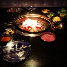 Iron Age Korean BBQ in Atlanta GA. Great food with fun lively atmosphere. Beef brisket on the grill.