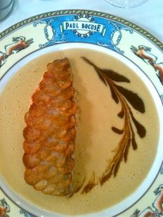 Epic dish from Paul Bocuse's restuarant in Lyon, France. It is red mullet encrusted with finely sliced potatoes.
