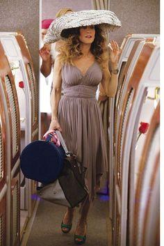 Carries Norma Kamali dress and Yohji Yamamoto hat. I hate the hat but love the dress.