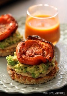 healthy snack - hummus and avocado toasts with roasted tomatoes by vonda