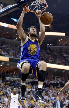 Description of . Golden State Warriors center Andrew Bogut, of Australia, dunks during the first half of Game 6 of a second-round NBA basketball Western Conference playoff series against the Memphis Grizzlies on Friday, May 15, 2015, in Memphis, Tenn. (AP Photo/Mark Humphrey)