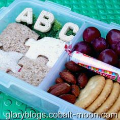 back to school bento with a puzzle sandwich, alphabet cookies and a package of SMARTIES.  how cute is that?!