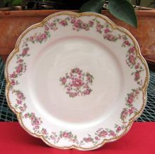 Haviland Limoges Antique Plate    Pattern Is Schleiger #270 A    A Favorite Antique Haviland Combination    Pink Roses And Gold Trim!    Haviland Schleiger #270 pattern has garlands of dark pink roses with green leaves on a scalloped and embossed blank trimmed in double gold.    It encircles this charming plate and is repeated in a center design.    Back stamp is shown and dates this china to the early 1900's.     $48.00