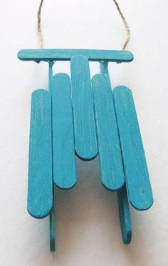 Sled Ornament - These little sled ornaments are super quick to put together and a great project for the kids to help with. (diy gifts with popsicle sticks craft ideas) Christmas Crafts For Kids, Christmas Projects, Kids Christmas, Holiday Crafts, Holiday Fun, Kids Winter Crafts, Popsicle Stick Crafts, Popsicle Sticks, Craft Stick Crafts