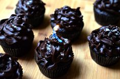 Dark Chocolate Cupcakes with Salted Chocolate Ganache Icing, could dessert get any better? Recipe from America's Test Kitchen