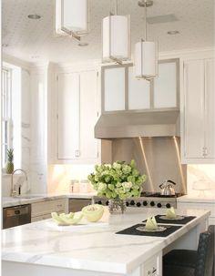 stainless hood modern pendants and marble white kitchen www.OakvilleRealEstateOnline.com