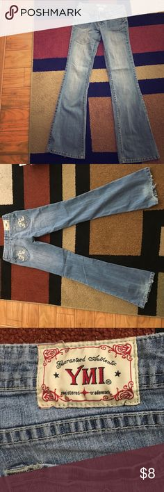 YMI Flare Jeans Light colored jeans with a flare at the bottom. They are a little frayed at the bottom but still stylish. I would rock them if they still fit me. YMI Jeans Flare & Wide Leg