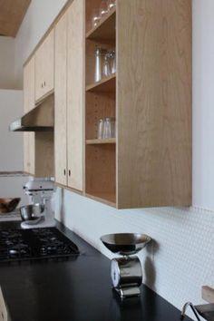 Gallery Remodelista- kitchen cabinet- finger holes instead of pulls. plywood shelves