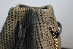 T shirt yarn crossbody mini bucket bag with black leather tassels. (pom pom doesn`t include) Best bucket bag for summer time, BEcause : Be eco ---> this bag made with eco-friendly T-shirt yarn! Be trendy ---> bucket bag is on top of fashion! Be unique ---> it`s a handmade crochet bag,