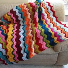 Ripples of Happiness - This crochet ripple blanket is sure to brighten up any room!