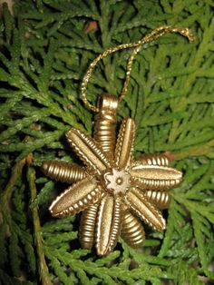 small pasta ornament painted gold