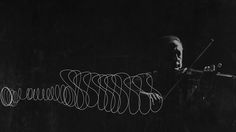 Photographer Gjon Mili attached a light to violinist Jascha Heifetz's bow and had him play in a darkened studio, letting the camera record the bow's movement.