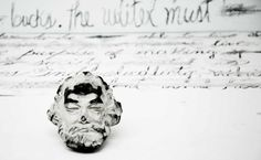 """(OUT OF BIENNALE) Venezuelan artist Deborah Castillo: """"Marx Palimpsesto"""" (2015) performance - installation around the ideological utopias and political vocation of art, from the Communist Manifesto (K. Marx and F. Engels ) that can be 'edited' with an eraser -shaped as Marx's head- making possible create new phrases and different interpretation of his thought."""
