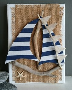 COASTAL ART by DriftwoodSails This sailboat has been lovingly hand-crafted using beautiful pieces of weathered driftwood, navy and white striped cotton sails, linen flag bunting, hessian and a tiny natural starfish. It is mounted on a box canvas . Sea Crafts, Seashell Crafts, Nature Crafts, Diy And Crafts, Kids Crafts, Arts And Crafts, Driftwood Projects, Driftwood Art, Deco Marine