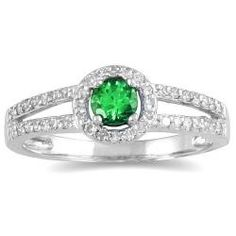Round emerald and diamond ring10-karat white gold jewelryguidehttp://www.overstock.com/Jewelry-Watches/10k-White-Gold-Emerald-and-1-4ct-TDW-Diamond-Ring-H-I-I1-I2/5318863/product.html?CID=214117 $294.99