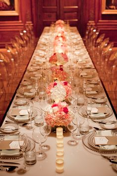 modern wedding with lucite tables, lucite chairs, pink flowers, glass and gold chargers
