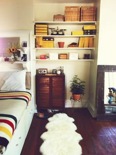 our bedroom (my side of the bed, i love stepping out onto my sheepskin rug) #pendleton #nationalgeographic #elvis