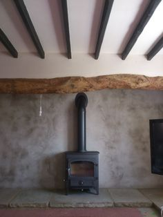 Sometimes the basics are best. Old cottage with newly rendered wall behind inside inglenook ,yorkstone paving, and pipe goes into an existing chimney.