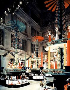 Giant Christmas candle carousels, Marshall Field & Company, main aisle, Chicago, about 1956 - photo featured at SMITHSONIAN.com