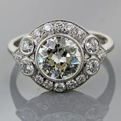 Vintage style halo engagement ring from ERD