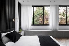 Tel Aviv designer Maayan Zusman has renovated a two-bedroom apartment in the city, with a range of custom details for its tall inhabitants. Renovation Design, Couple Bed, Living Room Arrangements, Safe Room, Glass Room, Two Bedroom Apartments, Contemporary Apartment, Grey Flooring, Design Studio