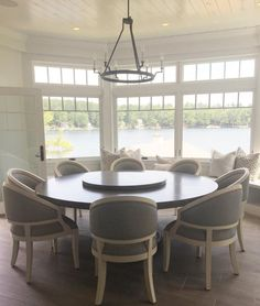 Kitchen Nook With Custom Round Table And Chairs With A Window Seat Under  Bay Windows With Transoms And Tongue And Groove Ceiling.