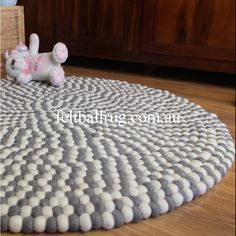 Grey And White felt ball rug is made from 100% New Zealand Wool and is handmade at our factory in Nepal. This grey and white felt ball rug is hand sewn together and can be used on both sides. These stunning rugs are perfect for any room in the For more inro, pls go to http://feltballrug.com.au