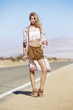 Hit the road in a lightweight floral wrap, white lace crop top, and slouchy brown shorts from the H&M Loves Coachella collection.│ H&M Loves Coachella