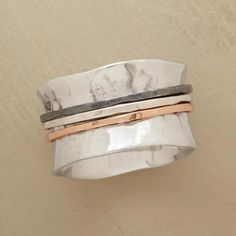 TRIAD SPINNER RING