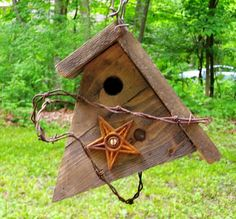 I love this!! genious using the barbed wire for the bird to stand on. Primitive Style Pine Wren Bird House by woodcliffcreations on Etsy, $24.00