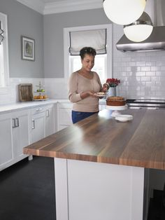 Formica but what wood island would look like -- Kitchen with white cabinets and laminate Wide Planked Walnut island Click through to get a free sample of Wide Planked Walnut Redo Kitchen Cabinets, Kitchen Worktop, Kitchen Redo, Kitchen Living, New Kitchen, Kitchen Remodel, White Cabinets, Kitchen Design, Laminate Countertops