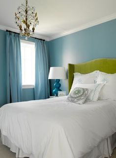 Bold bedroom! The curtains matching the walls looks unexpectedly great.