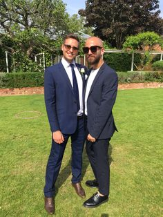 Liam and I in navy suits at a friend's wedding.