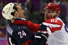 Evgeny Medvedev #82 of Russia fights with Ryan Callahan #24 of United States during the Men's Ice Hockey Preliminary Round Group A game (c) Getty Images