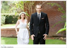 Photo as a Bride runs to greet her groom during their first look on their wedding day at the Marston House in Balboa Park in San Diego by La Vida Creations Photography