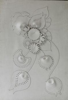 Bespoke Global - Product Detail - Camelia by Genevieve Bennett. A decorative leather wall panel made from hand cut and sculpted leather of the highest quality. Floral motifs inspired by the Camelia flower are set onto an upholstered background made of the same leather.