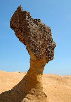 This formation is located in Yehlia Geopark, Taiwain – an area of unusual natural formations of sandstone with limestone rocks which have been sculpted by wind and sea erosion.  The erosion process left interesting pillar and mushroom-shaped formations scattered throughout the site. Many of them have interesting names such as the Queen's Head (the most famous formation shaped like Queen Nefertiti), Fairy's Shoe, Candle, Stone Heart, Bean Curd, Dragon Head, www.RevWill.com