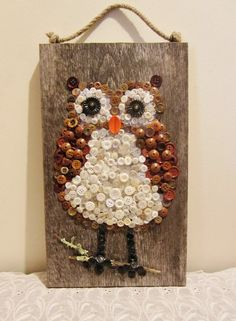 Large Owl Wall Hanging on Barn Board Made of Buttons. $45.00, via Etsy.
