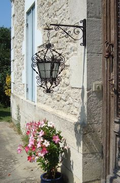 Wrought iron lantern, Hanging lantern, Lantern with support, French country, Outdoor lighting, Exterior lantern, Wall lantern, Ornate light Country Charm, French Country, Wrought Iron Chandeliers, Hanging Lanterns, Wall Lantern, Antique Clothing, French Vintage, French Antiques, Outdoor Lighting