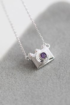 Are you a photographer? Locve photography? Then this necklace is perfect for you! An elegant accessory, this dainty camera necklace has a high polished finish for an eye-catching shine. - 2016 New Vers                                                                                                                                                      More