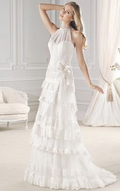 A touch of shabby chic romance! This gorgeous dress has layers of scalloped lace and a lace halter top with high neck. The layers fall into a sweep, floor-length train. A halter button up back ads a t