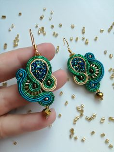 Small soutache earrings in blue, green and gold
