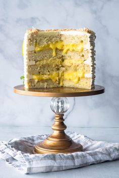 This Lemon Coconut Layer Cake is an elegant dessert that will impress your guests. It\'s a vanilla cake with the bottom and top layers filled with lemon curd, the middle layer is filled with coconut custard. The cake is covered in Italian Meringue Buttercream.