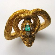 Victorian snake bangle, the bangle in the form of a writhing snake, embellished with ornately-carved serpent scales and elaborate scroll motifs, an emerald-cut emerald set to the centre of its head, Snake Bracelet, Snake Jewelry, Animal Jewelry, Fine Jewelry, Victorian Jewelry, Antique Jewelry, Vintage Jewelry, Victorian Gold, Selling Jewelry