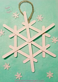 Easy and Cute Diy Popsicle Stick Snowflake Winter Craft - Have fun with these easy homemade Snowflake Popsicle Stick Christmas Ornaments! Share in the classr - Diy Christmas Snowflakes, Snowflake Craft, Kids Christmas, Christmas Decorations, Christmas Ornaments, Simple Snowflake, Christmas Presents, Tree Decorations, Snowman Crafts