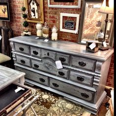 Dark gray distressed glazed dresser.