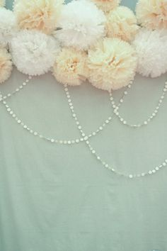 wall decor - navy, ivory and grey poms with ribbon and garland strings looped…
