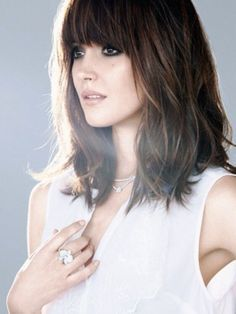 Shoulder length bob with bangs; nice body with blended layers for volume and very subtle highlights on slightly waved dark brown hair with the piece-y effect I love