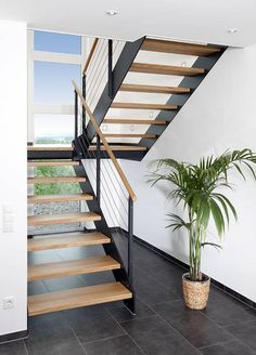 Cage escalier SteelLine – BÄTHE Treppen GmbH How much water does a lawn really need? Open Staircase, Floating Staircase, Staircase Design, Floating Shelves, Wood Stairs, House Stairs, Stair Railing, Steel Stairs, Stairs Architecture