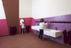 Sinnewandel Kindergarten in Berlin designed by Baukind and Atelier Perela. Scaled basins and colourful tiles.